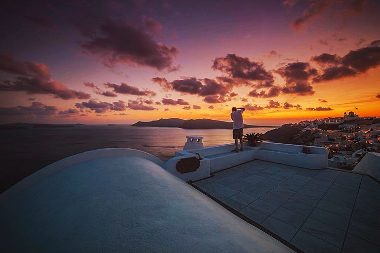 Vista Islandlife Greece Pink Sky Destination Holiday POV Sea And Sky Looking Down View From Above Santorini, Greece Sea Sunset Water Vacations Horizon Over Water Dusk Cloud - Sky One Person Scenics Relaxation Sky Go Higher Summer Exploratorium