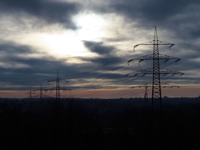 Electricity  Electricity Pylon Technology Sky Connection Cloud - Sky Power Line  Silhouette Cable Fuel And Power Generation Power Supply Scenics - Nature Global Communications Sunset Winter Sun Winter Sunset Dramatic Sky Dramatic Power Lines Power Lines Against Sky Clouds And Sky Clouds Blazing Pylon Industrial Landscapes