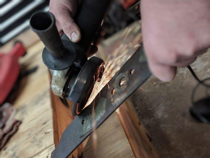 Cropped Hands Sharpening Meta