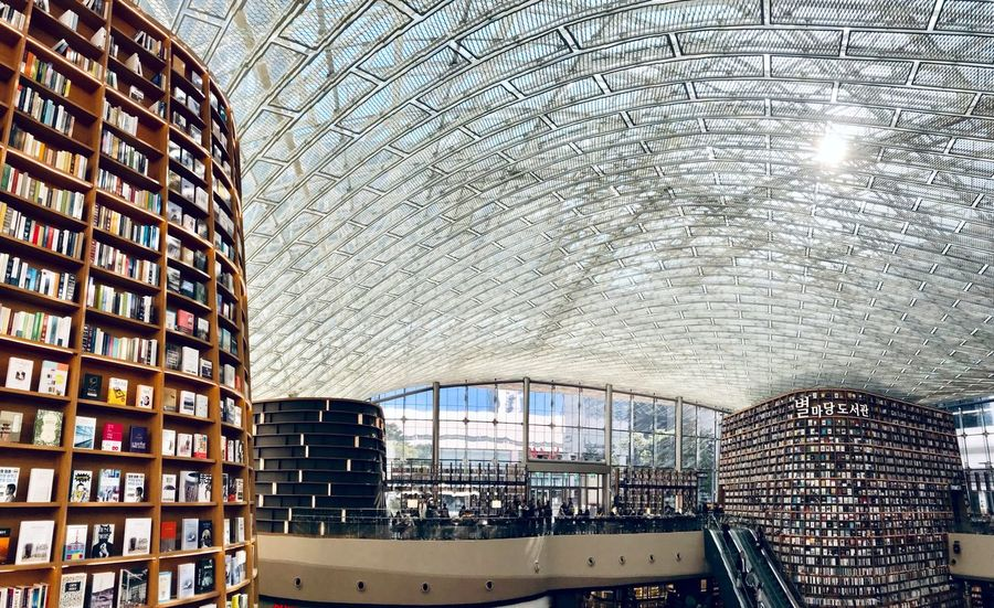 Seoul, Korea Seoul ShotOnIphone Starfield Library Books Library Modern Architecture Glass Roof Building Exterior Architecture Built Structure City Glass - Material Building Day No People Sky Travel Destinations Transparent Travel Modern Outdoors Water Window Office Building Exterior