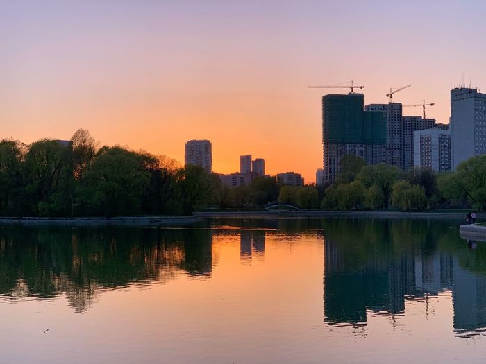 Good night all!! 😘✨ IPhoneography Evening Spring Springtime Park Reflection Sky Sunset Architecture Building Exterior Built Structure Water City Building Tree Nature No People Plant Waterfront Lake Orange Color Landscape Urban Skyline Modern