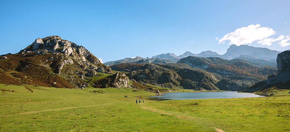 Beautiful landscape of valley with lake between mountains on a sunny day Horizontal Lake Paradise Vegetation Green Landscape Sky Blue Scenery Mountain Scenics Lakeside Ecology Natural Tree Grassland Field Valley Covadonga Asturias SPAIN Picos De Europa Enol Lake Ercina Lake Beautiful