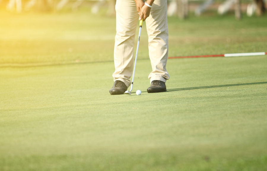 Adults Only Golf Golf Ball Golf Club Golf Course Golf Shoe Golfer Green - Golf Course Human Body Part Leisure Activity Lifestyles Low Section Men Nature One Man Only One Person Only Men Playing Putting Putting Green Sport Sportsman Standing Taking A Shot - Sport Weekend Activities