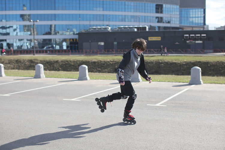 Teenage Girls Teenagers  Rollerskating Roller Skate Girl Architecture Building Exterior Built Structure Casual Clothing City Day Full Length Leisure Activity Lifestyles Motion Nature One Person Outdoors Real People Roller Skate Shadow Side View Skill  Sport Sunlight