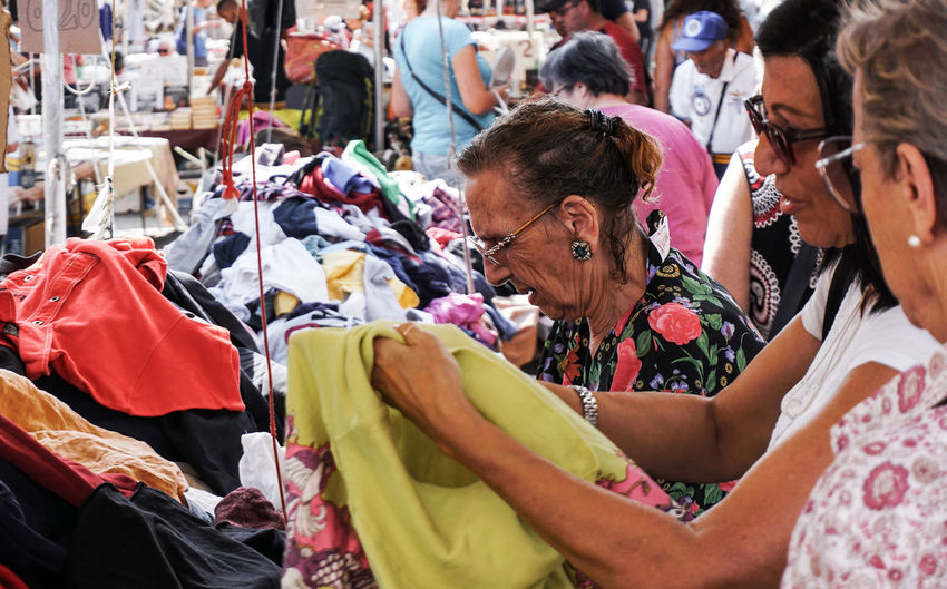 women buying clothing in Catania, Sicily, Italy Catania Sicily Street Photography Streetphotography Buying Clothing Fashion Women Real People Incidental People Shopping Market