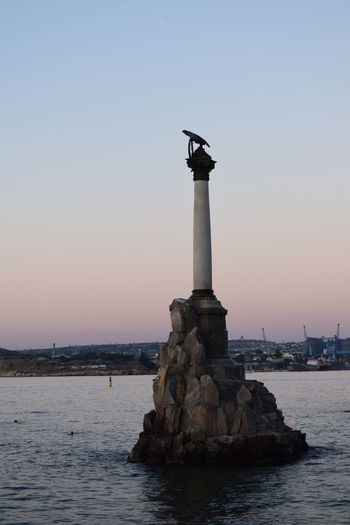 памятник затопленным кораблям Beauty In Nature Black Sea Crimea Idyllic Lighthouse Monument Nature No People Outdoors Rippled Rock Rock - Object Scenics Sea Sevastopol  Sky Sunset Sunset Silhouettes Tranquil Scene Tranquility Water