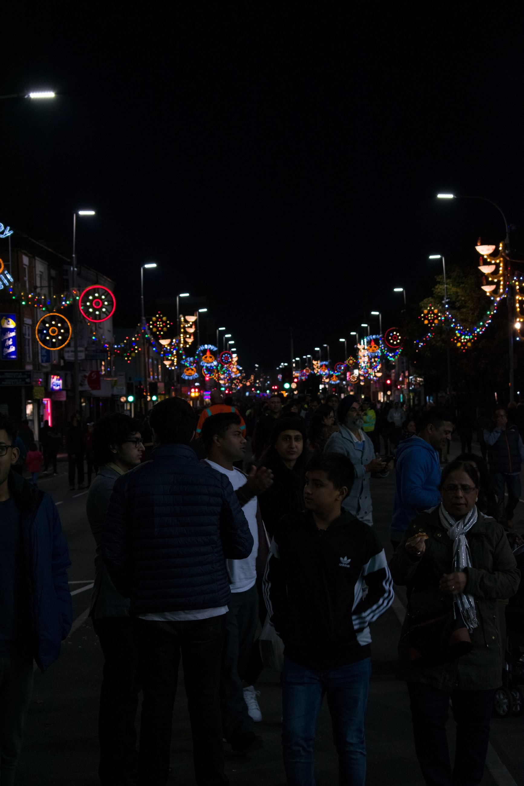 night, large group of people, illuminated, celebration, city, outdoors, men, people, real people, sky, adults only, crowd, adult