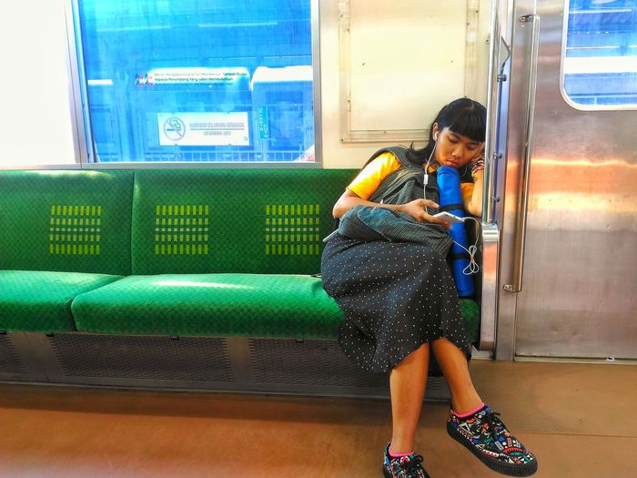 snapshot girl in train want go home Student Girlsleeping Streetphotography Snapshot Of Life ClashOfColors Street Photography Press For Progress Humaninterest Train Train To Bekasi In Sunday Humanphotography Full Length Indoors  People One Person Day Colour Your Horizn EyeEmNewHere Real People Sitting