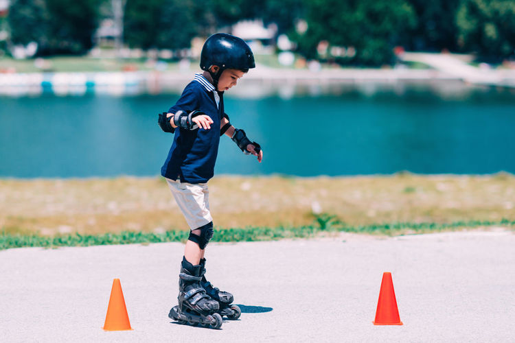 Boy on Roller skating Class Rollerskating Roller Sport Outdoor Kid Fun Child Cones Active Ride Rollerblading Learning Teaching Roller Skating Senior Skate Young Happy Blade Rollerblade Road Boy Summer Skater Park Activity Smile Helmet Blades Rollerblader Family Protector Pads Knee Pads Recreation  Protection Safe Sporty Enjoy Rollerblades Balance People Roller Skate Day One Person Nature Sports Equipment