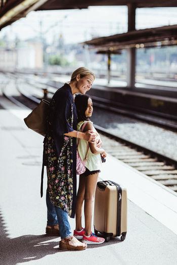 Woman standing on railroad station platform