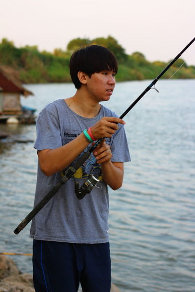 NongKhai,ThaiLand Boys Casual Clothing Catch Of Fish Childhood Chumphon_TH Fish Fishing Fishing Net Fishing Pole Fishing Rod Fishing Tackle Focus On Foreground Holding Leisure Activity Lifestyles My Farm Life One Person Outdoors Real People River Standing Three Quarter Length Water Weekend Activities