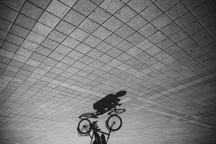 Upside down shot of person riding bicycle