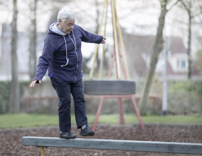 Full length of man on bench in park