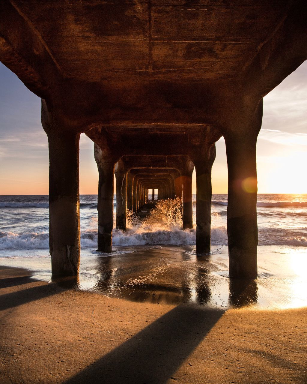 underneath, water, sea, below, bridge - man made structure, nature, architectural column, architecture, built structure, sunset, sunlight, beach, outdoors, sky, under, scenics, day, no people, horizon over water, beauty in nature