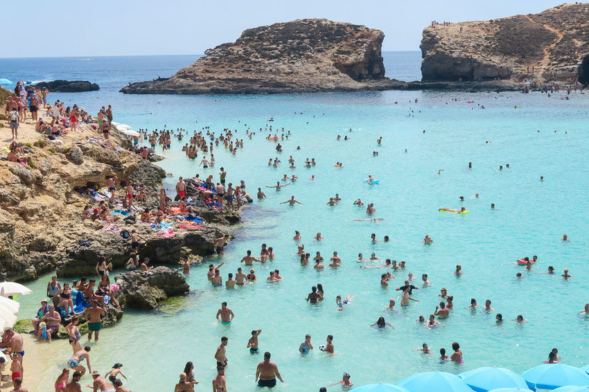 Comino Island, Malta - 03 August 2016: Tourists at the Blue Lagoon. The most famous and crowded beach in Malta with crystal clear waters. Beach Beach Scene  Beauty In Nature Blue Lagoon Malta Coastline Comino Island Malta Crystal Clear Beach Holiday Beach Lagoon Lagoon Water Lagoons Landscape Malta Malta Beach Malta Landscape Maltese Mediterranean Beach Pradise Republic Of Malta Summer Beach Summer Vacation Swim Travel Destinations Valletta Valletta European Capital Of Culture 2018