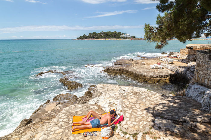 Lay in the Porec sun... Beach Life Croatia Porec, Croatia Poreč Coast Rocky Beach Adult Beach Beauty In Nature Croatian Landscape Croatian Sea Day Leisure Activity Lying Down Nature One Person Outdoors People Porec Real People Sea Seaside Sky Sunbathing Vacations Water