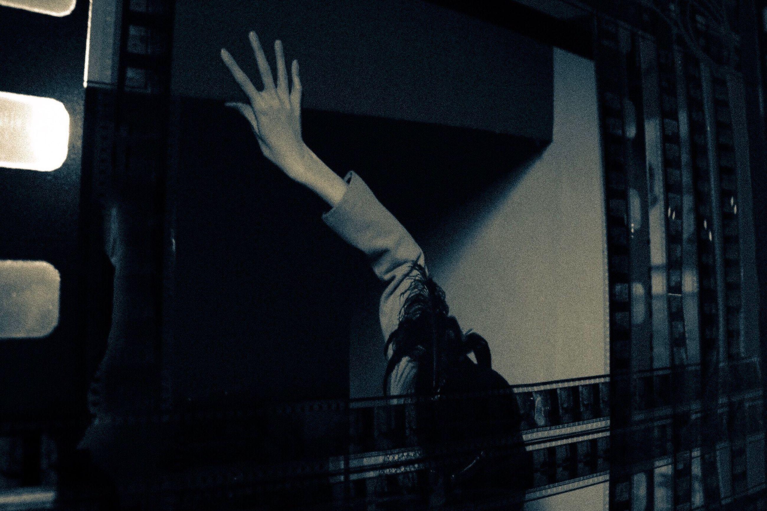indoors, night, men, one person, human body part, illuminated, people, human hand