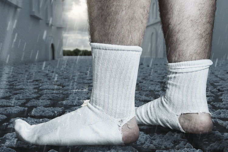 standing feet with white socks and a big hole standing on cobblestone street. Concept homelessness and poorness Homeless Cobblestone Rainy Poor  Socks Holes Walking Close Up Worn Close-up Low Angle View Lifestyle Awkward Detail Outdoor Shabby Man Male Footwear Leg Crisis Foot