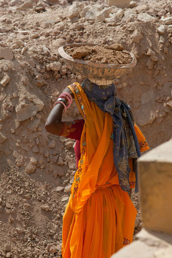 Woman doing hard labor on historical sites in Rajasthan Amber Construction Hard India Manual Labor Woman Working Working Hard Adult Amber Fort Clothing Hard Labor Labour Outdoors Palace Rajasthan Real People Saree Standing Traditional Clothing Women