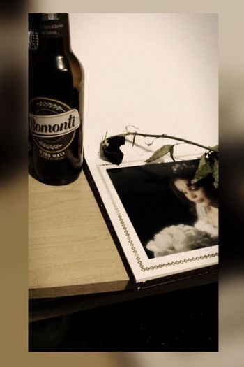 Mom Mother Dierose Rosenrote Bottle Indoors  Book Text Communication Technology Table No People Close-up Eyeglasses  Musical Note Animal Themes Day Keyboard Beer Piva Bomonti Alone Music Notvolume