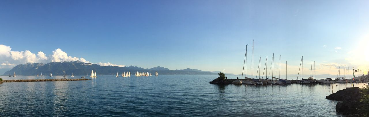 Panoramic view of boats on lake geneva against sky