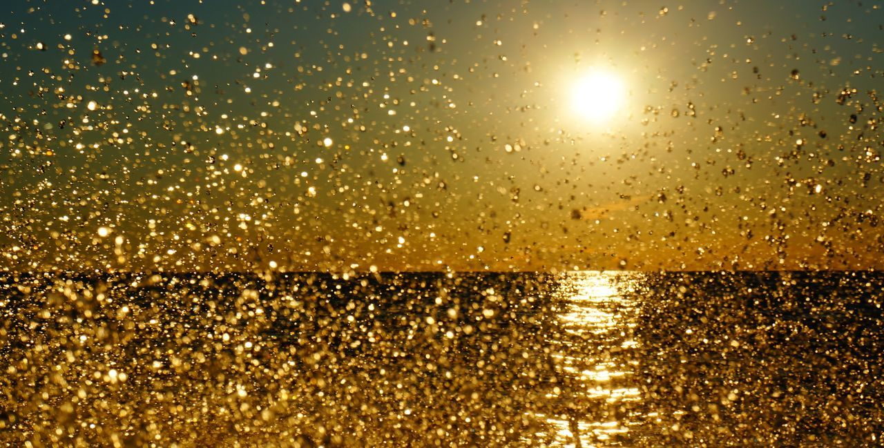 gold colored, illuminated, sun, glowing, reflection, backgrounds, shiny, bright, gold, sunset, yellow, water, glitter, christmas, sunlight, no people, nature, outdoors, sky, beauty in nature