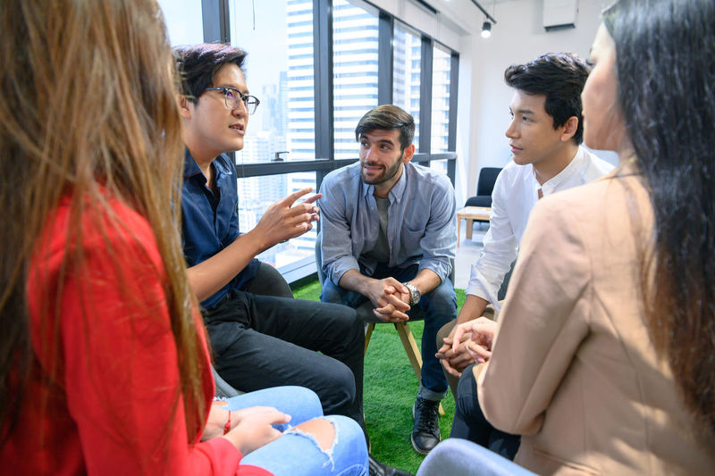 Group psychotherapy for support and helping worried man to change negative mindset