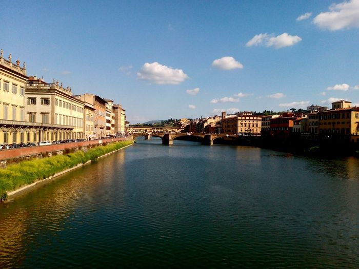 Ponte Vecchio Over River Amidst Buildings Against Sky