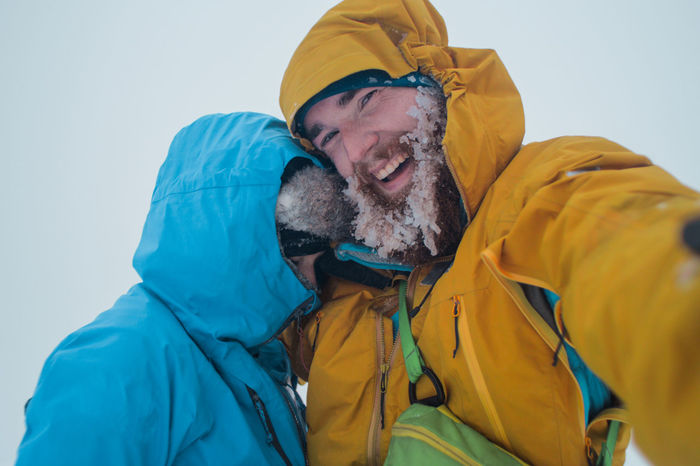 winter alpine misery, selfie of a two mountaineers caught in a bad winter snowstorm weather, Alpine Backpacking Emergency Hiking Man Mountaineering Travel Trekking Active Adult Adventure Climbing Close-up Clothing Cold Cold Temperature Danger Emotion Happiness Headshot Hood - Clothing Leisure Activity Lifestyles Males  Mature Adult Mature Men Men People Portrait Selfie Smiling Snow Snowstorm Survival Togetherness Trail Two People Warm Clothing Winter
