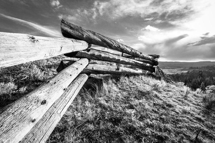 Log cabin against sky