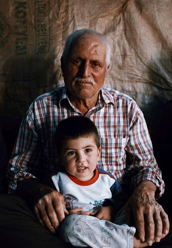 Turkish family living on mountains (grandpa with his grandkid) EyeEmNewHere #travel Kid Grandpa Mountain Portrait Streetphotography Turkey Child Childhood Males  Togetherness Family Men Bonding Real People Emotion First Eyeem Photo