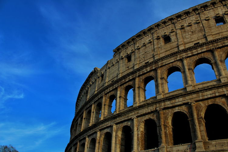The Colliseum from the view of anyone passing by. EyeEm Selects City Ancient Civilization Arts Culture And Entertainment Blue Old Ruin History Ancient Arch Monument The Past Amphitheater Archaeology Roma Civilization Roman Ancient Rome Ancient History Ruined