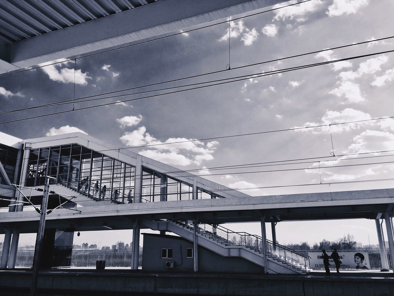 sky, cloud - sky, architecture, connection, built structure, low angle view, day, bridge - man made structure, transportation, cable, outdoors, men, building exterior, real people, city, people
