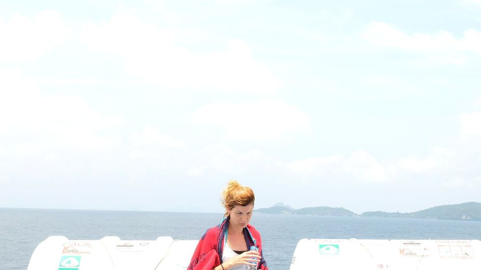 EyeEm Selects Sea Beach Cloud - Sky One Person Only Women Day Leisure Activity Sky Outdoors People One Woman Only Vacations Adults Only Water Enjoyment One Young Woman Only Summer Young Adult Sand Nature Gingerhair Orange Orange Hair Travel