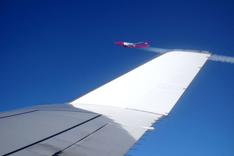 Rare encounter over Greenland Air Travel  Aircraft Aircraft Wing Airplane Blue Blue Sky Boeing Boeing 747 Commercial Airplane Condensation Trail Encounter Flying Flying High Greenland In Flight Jumbo Jet Overtaking Passing By Speed Sunlight Sunlit Tourism Vapour Trail White Color Winglet