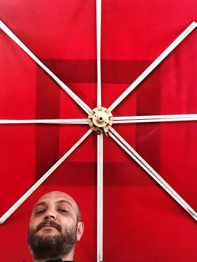 Low angle view of man in red ceiling