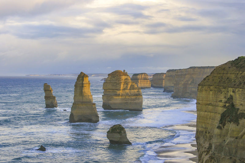 Scenic view of the twelve apostles against cloudy sky