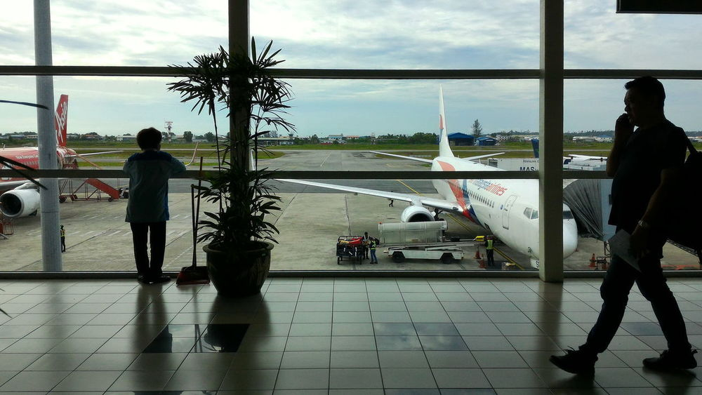 Passageway at Miri Airport. Passenger Miri Airport Air Asia Malaysia Airlines Full Length Silhouette Adult People Cloud - Sky Airport Adults Only