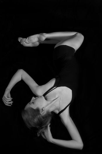 Black and white photo of woman ballet dancer. Woman Black Background Studio Shot Black Background Indoors  One Person People Ballet Ballerina Ballet Dancer Dance Dancer Fine Art Black And White Art Contemporary Pose Body Part Body & Fitness Body Curves  Legs Adult Dancing Full Length Exercising Young Adult Elégance Sport Skill  Stretching Side View Balance Young Women Figure