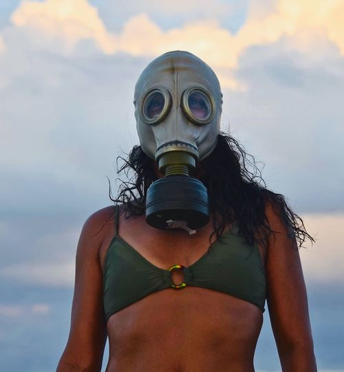 Welcome to the Florida Gulf Coast Gas Mask Florida Gulf Coast Red Tide Gulf Of Mexico One Person Sky Real People Lifestyles Portrait Nature Front View One Person Sky Real People Lifestyles Portrait Nature Front View