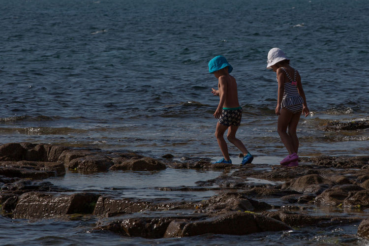 Friends Summer Exploratorium Tuscany Beach Beachphotography Child Italy Kid Land Leisure Activity Nature Positive Emotion Rock Seaside Togetherness Two People Water