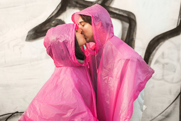 Couple Date Kiss Pink Rain Romance Affection Bonding Plastic Poncho Real People Urban