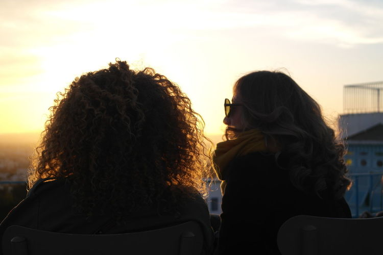 EyeEm Best Shots Adult Bonding Couple - Relationship Curly Hair Hair Hairstyle Headshot Leisure Activity Lifestyles Love Nature Outdoors People Portrait Positive Emotion Real People Rear View Sky Sunset Togetherness Two People Women Young Adult Young Women