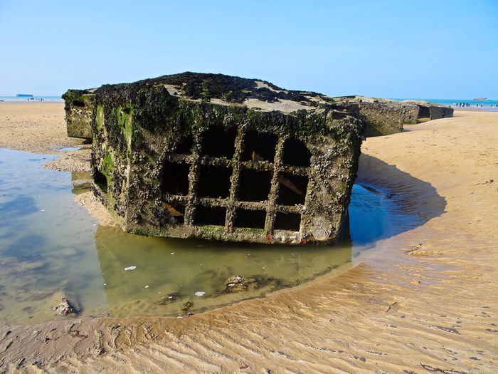 The remains of beetles, floating supports for the roadway of the Mulberry Harbour during WWII. Beach Beach Photography Beauty In Nature Beetle Clear Sky Close-up Day Mulberry Harbour Nature No People Normandy Normandy Beach Normandy Landing Normandybeach Outdoors Sand Sea Sea And Sky Seaside Sky Tranquility Water Wreck WWII WWII History