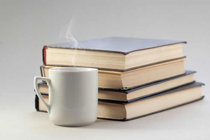 Book Close-up Coffee Cup Cup Education Focus On Foreground Hardcover Book Indoors  Large Group Of Objects Learning Literature Mug No People Publication Stack Still Life Studio Shot Studying Table White Background Wisdom