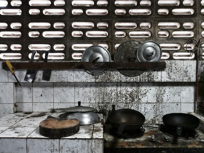 Close-up of old utensils in abandoned kitchen