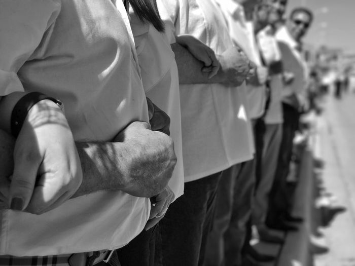 Linking arms at a bipartisan Rally At The Border. Border Life Del Rio Tx Radney Foster No Wall Protest The Resistance Real People Blackandwhite Photography Black And White Photography Human Hand Men Resist Black&white Resist Connected By Travel
