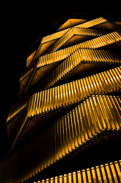 Warking Around Low Angle View City Night Photography Building Illuminated Full Frame Backgrounds Pattern Close-up Architecture Sky Spiral Staircase Zigzag Spiral Architectural Design Office Building