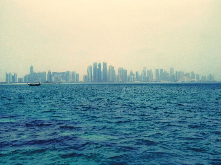 Corniche Doha Skyline Westbay Dusty Smartphone Photography Eyem Gallery Qatar Qatar4u Skyline Climatechange Blue Wave The Great Outdoors - 2016 EyeEm Awards