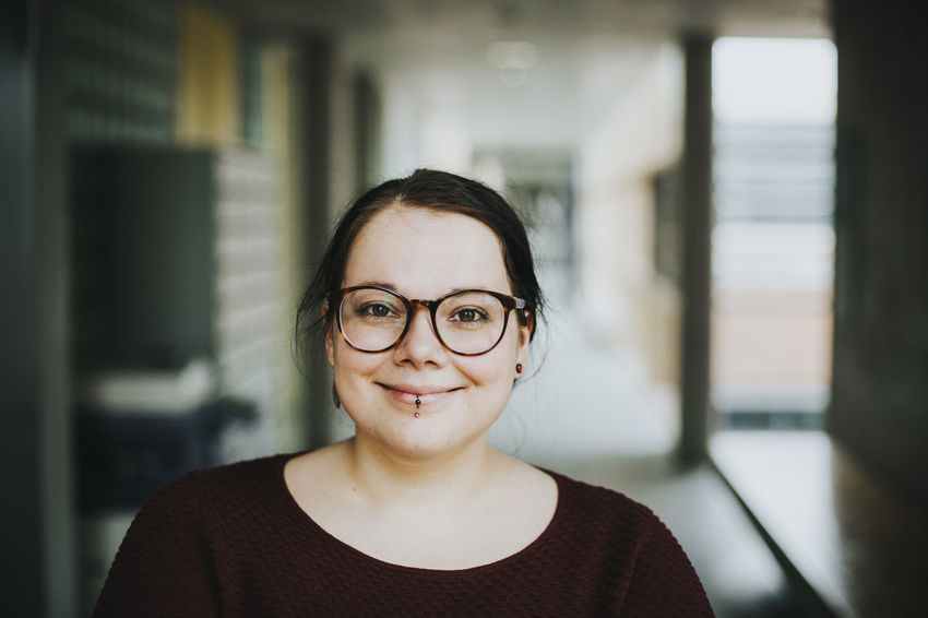 Headshot of a young brunette woman smiling Confidence  Happiness Happy Headshots Positive Adult Close-up Confident  Day Eyeglasses  Focus On Foreground Front View Headshot Headshot Photography Indoors  Laugh Looking At Camera One Person People Portrait Real People Smiling Smiling Face Young Adult Young Woman